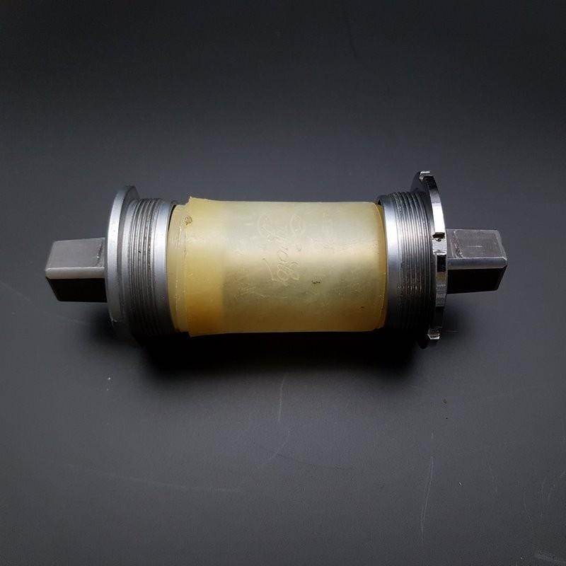 """Axe de pédalier """"CAMPAGNOLO CHORUS"""" 111 mm BSC 1.37 x 24 (Ref 302)"""